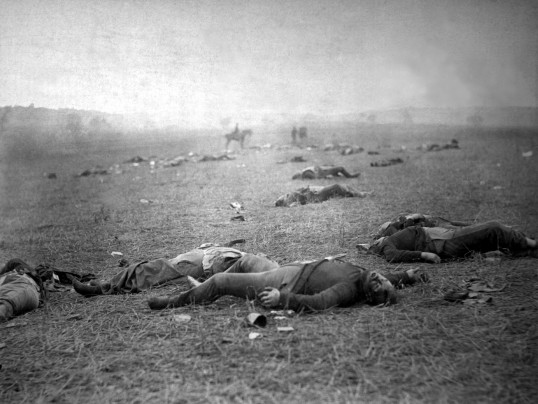 A Harvest of Death; Union dead at Gettysburg, July 5, 1863, taken by Timothy O'Sullivan; the men were killed in fighting on the Rose farm, near the Peach Orchard, Devil's Den, and Little Round Top, on July 2 (Library of Congress)